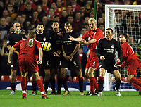 Photo: Javier Garcia/Back Page Images Mobile +447887 794393 Liverpool v Olimpiacos, UEFA Champions League 08/12/04, Anfield<br />Sami Hyppia looks stunned as Steven Gerrard dinks the ball over the Greek wall instead of going for goal
