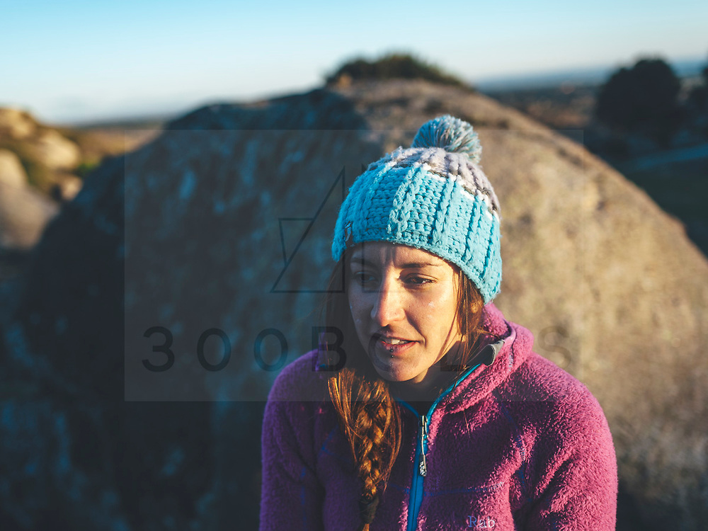 Rab climbing athlete Lara Molina enjoying a boulder winter afternoon in Zarzalejo, Spain