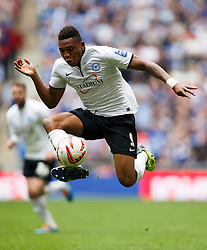 Peterborough Forward Britt Assombalonga (COD) in action - Photo mandatory by-line: Rogan Thomson/JMP - 07966 386802 - 30/03/2014 - SPORT - FOOTBALL - Wembley Stadium, London - Chesterfield FC v Peterborough United - Johnstone's Paint Trophy Final.
