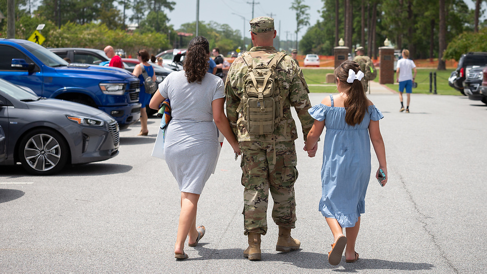 FORT STEWART, GA - JULY 17, 2019: Georgia National Guard SPC Justin Purvis, center, hold hand with his wife Stephanie Purvis, left, and his daughter Isabella Purvis of Dalton, Ga., during a homecoming ceremony for the soldiers of the Macon-based 48th Infantry Brigade Combat Team Wednesday, July 17 2019 at Ft. Stewart, Ga. The unit finished a seven month deployment to Afghanistan in support of Operation Resolute Support. (AJC Photo/Stephen B. Morton)