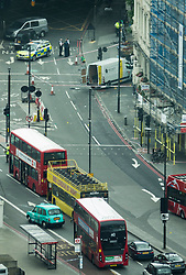 © Licensed to London News Pictures. 04/06/2017. London, UK. A rental van (top right) is seen where it stopped just over London Bridge -  it is believed to have been driven by three men in an attack which killed seven and injured at least 48. Police shot three attackers dead after they deliberately drove at people on London Bridge and then stabbed drinkers at bars in nearby Borough Market. Photo credit: Peter Macdiarmid/LNP