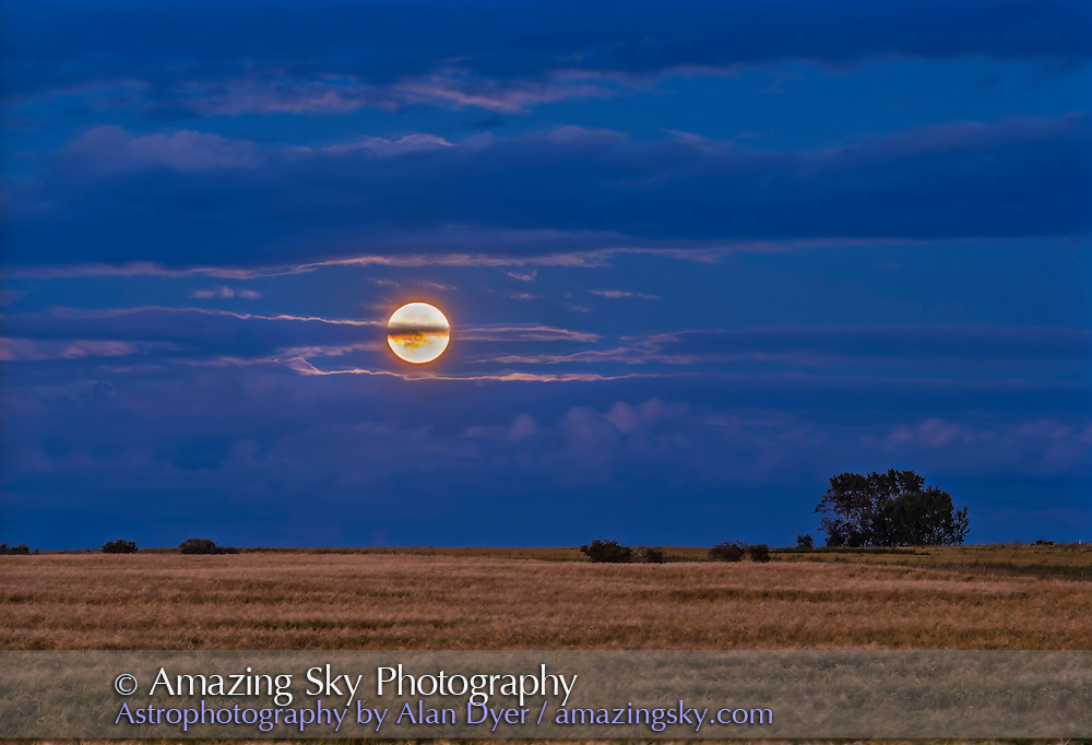 The Full Moon of August 18, 2016 - the &ldquo;Sturgeon Moon&rdquo; - rising amid cloud over a wheatfield.<br /> <br /> This is a 5-exposure stack blended with luminosity masks, and shot with the Canon 60Da and 135mm telephoto.