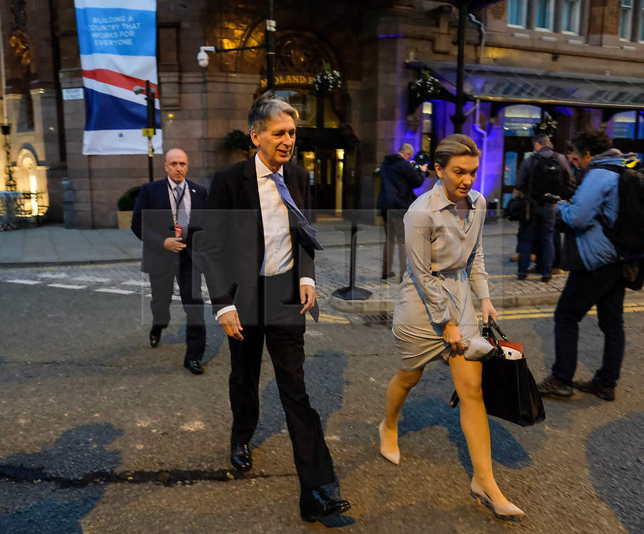 (c) Licensed to London News Pictures. <br /> 02/10/2017<br /> Manchester, UK<br /> <br /> Chancellor of the Exchequer Philip Hammond leaves the Midland Hotel as he walks to the the Conservative Party Conference held over four days at the Manchester Central Convention Complex.<br /> <br /> Photo Credit: Ian Forsyth/LNP
