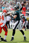 Philadelphia Eagles quarterback Carson Wentz (11) is pressured by Cleveland Browns defensive back Ibraheim Campbell (24) as he throws a second quarter pass for a short gain during the 2016 NFL week 1 regular season football game against the Cleveland Browns on Sunday, Sept. 11, 2016 in Philadelphia. The Eagles won the game 29-10. (©Paul Anthony Spinelli)