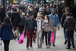 © licensed to London News Pictures. London, UK 15/12/2012. People shopping on Oxford Street in London on second last weekend until the Christmas. Photo credit: Tolga Akmen/LNP