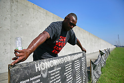 29 August 2013. Lower 9th Ward, New Orleans, Louisiana.<br /> Hurricane Katrina memorial 8 years later. <br /> Unfurling the names honoring those who perished when hurricane Katrina swept ashore.<br /> Photo; Charlie Varley