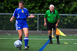 Soccer Official Aubrey Cashman, right, watches the line during a Junior Varsity game on Tuesday. <br /> <br /> Cashman and his team consisting of 70 year old Henry Woo, and the pup in his fifties Frank LaBoone worked soccer matches between Lexington Catholic and Henry Clay, Tuesday, Aug. 13, 2013 at Lexington Catholic Soccer/Football Stadium in Lexington. Photo by Jonathan Palmer