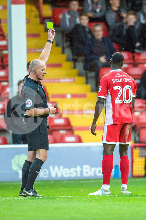 Match Referee Graham Salisbury shows the Yellow card to Amadou Bakayoko of Walsall during the EFL Sky Bet League 1 match between Walsall and Shrewsbury Town at the Banks's Stadium, Walsall, England on 7 October 2017. Photo by Darren Musgrove.