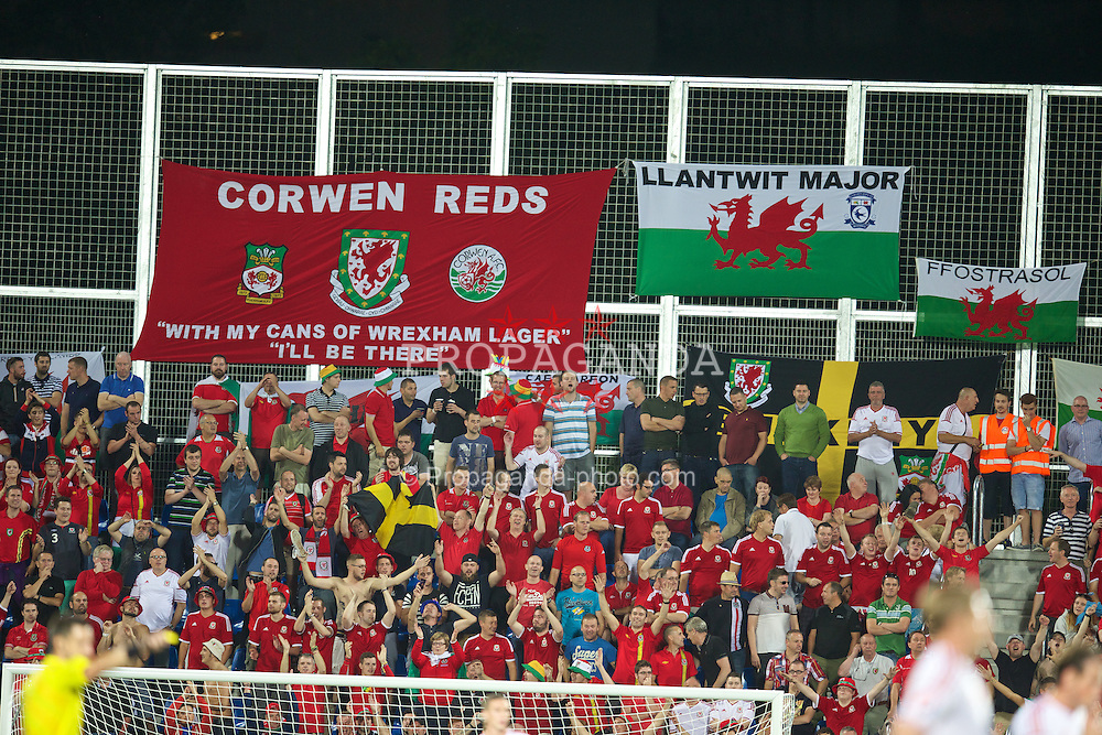 ANDORRA LA VELLA, ANDORRA - Tuesday, September 9, 2014: Wales supporters celebrate against Andorra during the opening UEFA Euro 2016 qualifying match at the Camp d'Esports del M.I. Consell General. (Pic by David Rawcliffe/Propaganda)