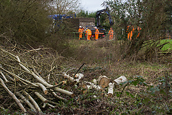 Denham, UK. 4 February, 2020. Engineers prepare to unload a temporary roadway from a large truck to be used for works for the HS2 high-speed rail link project. Planned works in the immediate vicinity are believed to include the felling of 200 trees and the construction of a roadway, Bailey bridge, compounds, fencing and a parking area. Credit: Mark Kerrison/Alamy Live News