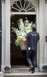 © Licensed to London News Pictures. 15/07/2016. London, UK. A giant basket of flowers are delivered to Downing Street for new Prime Minister Theresa May.  Photo credit: Peter Macdiarmid/LNP
