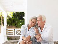 Senior couple sitting on verandah