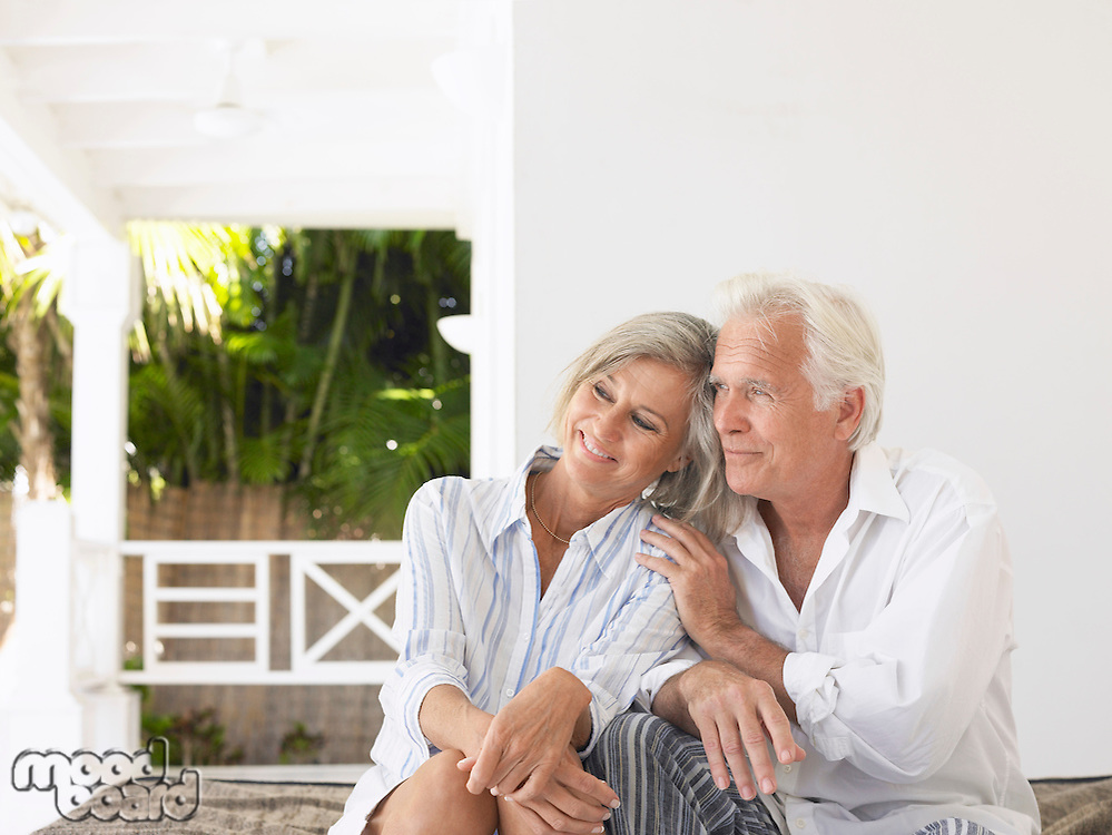 Senior couple sitting on verandah