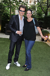 VICTORIA AITKEN and HENRIQUE SCHIEFFERDECKER at a garden party hosted by Piaget at The Hempel Hotel, London on 14th July 2011.