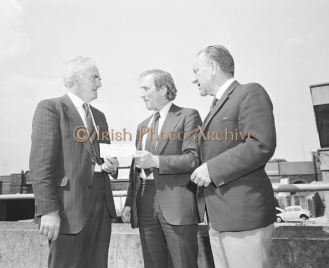 Officials present a cheque at Croke Park on the 29th of June 1974.