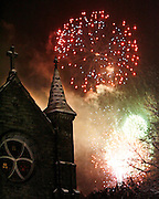 Roger Crowley / CrowleyPhotos.com..Fourth of July fireworks light up the steeple of Christ Church in Montpelier Vermont.