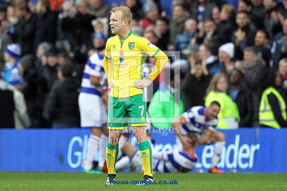 Steven Naismith of Norwich looks dejected as the QPR players celebrate their side&rsquo;s 2nd goal during the Sky Bet Championship match at the Loftus Road Stadium, London<br /> Picture by Paul Chesterton/Focus Images Ltd +44 7904 640267<br /> 19/11/2016