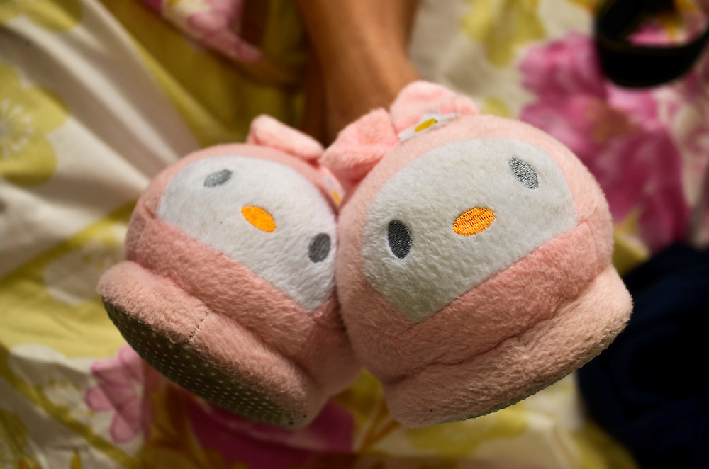 Leibis Mendoza, 16, wears Hello-Kitty slippers after giving birth in a free government maternity clinic in Caracas, Venezuela...16.)