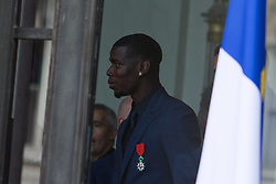 France's national team forward Paul Pogba looks on as he leaves after receiving the Legion of Honour during a ceremony to award French 2018 football World Cup winners, on June 4, 2019, at the Elysee Palace in Paris. Photo by Raphael Lafargue/ABACAPRESS.COM