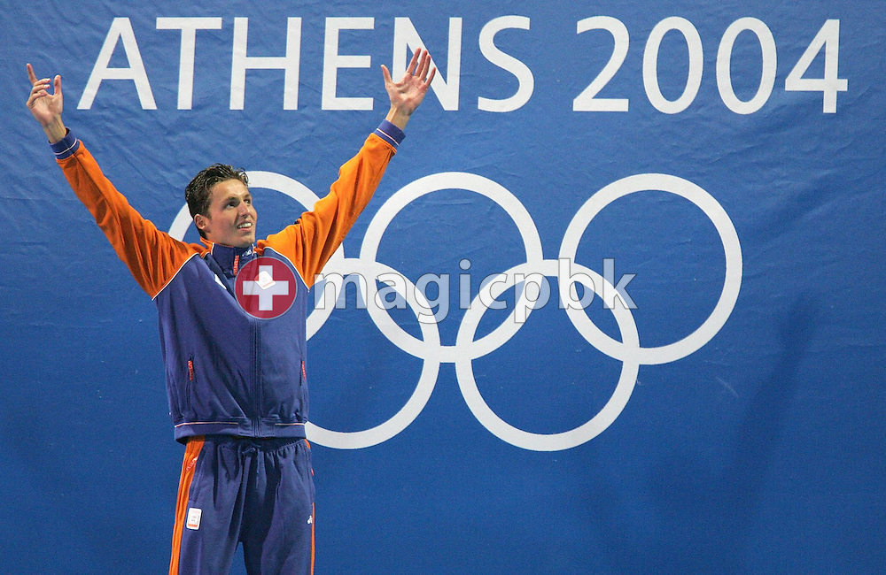 Dutch Pieter van den Hoogenband jubilates during the flower ceremony of the men's 100m Freestyle final at the Athens Olympic Aquatic Centre, Wednesday 18 August 2004.     (Photo by Patrick B. Kraemer / MAGICPBK)