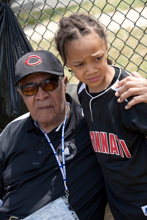 WASHINGTON, DC- OCTOBER 12 Chuck Harmon, the first African-American to play for the Cincinnati Reds in 1954, hugs  his great-granddaughter Mitchell Edmond after her little league game on Saturday, June 4, 2011. (Michael Temchine for The Washington Post)