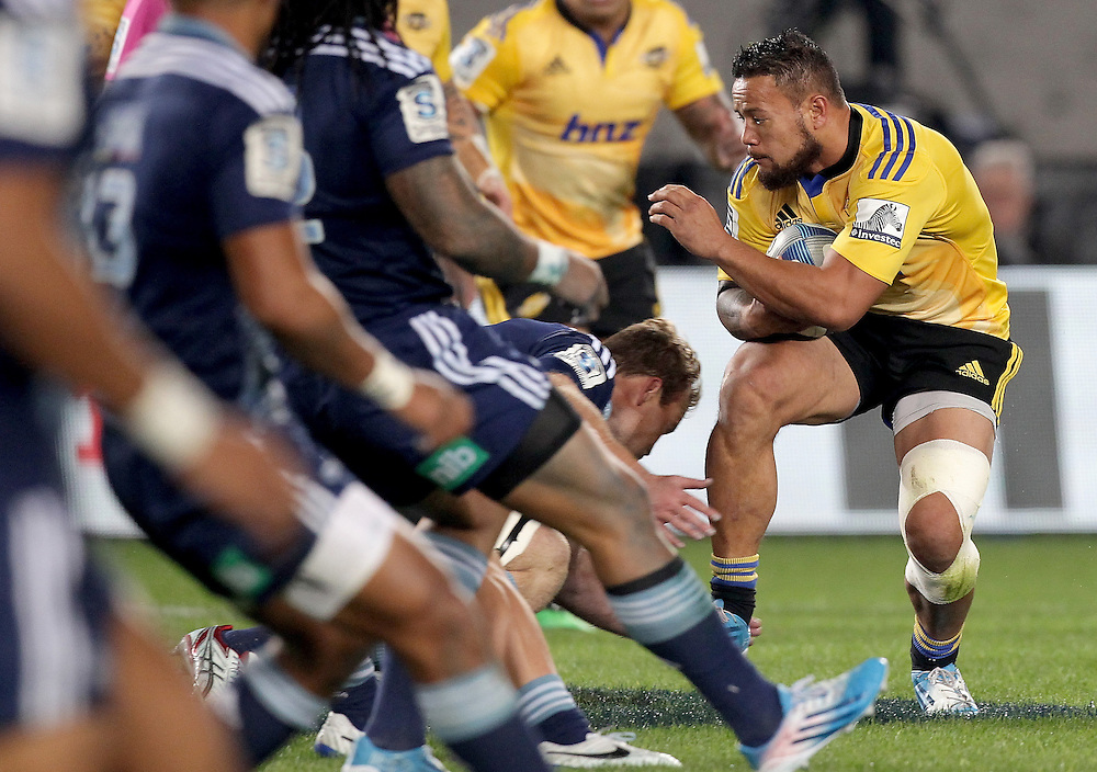 Hurricanes' Alapati Leiua on the attack against the Blues in a Super Rugby match, Eden Park, Auckland, New Zealand, Saturday, May 31, 2014.  Credit:SNPA / David Rowland