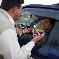 Imran Khan and members of his polical party Tehrik-e-insaaf meet Khan's constituents in Mianwali. Imran Khan became a Member of the Pakistani Parliament for Mianwali, Panjab, in the October 2002 elections.<br /> <br /> Cricketer Imran Khan made his Test debut against England in 1971. He became captain of the Pakistan team in 1982 and lead them to World Cup victory in 1992 after which he retired.<br /> <br /> Imran Khan established the Tehrik-e-insaaf (or Moverment for Justice) in 1996. Through Tehrik-e-insaaf, Khan has demanded that the Pakistan government make institutional reforms to address corruption and end the present dictatorship. Khan would like a more equitable distribution of resources in Pakistan, the granting key civil liberties and an increas in public service spending. He is particularly scathing of the relationship between President Musharraf and US President Bush.<br /> <br /> Photo: Tom Pietrasik<br /> Panjab, Pakistan<br /> 28th January 2006