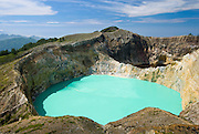 Brilliantly colored lakes at the summit craters of Kelimutu volcano, Flores, Indonesia.
