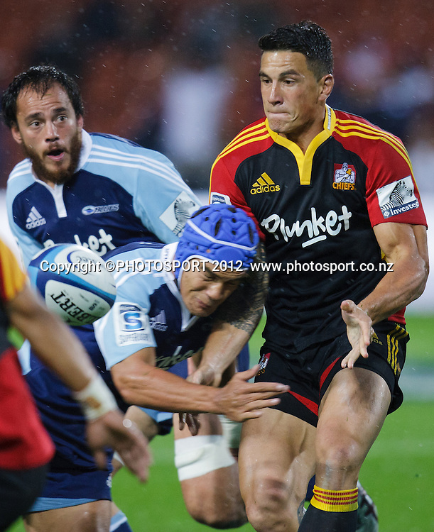 Chiefs' Sonny Bill Williams gets his pass away under the tackle of Benson Stanley during the 2012 Super Rugby season, Chiefs v Blues match at Waikato Stadium, Hamilton, New Zealand, Friday 2 March 2012. Photo: Stephen Barker/PHOTOSPORT