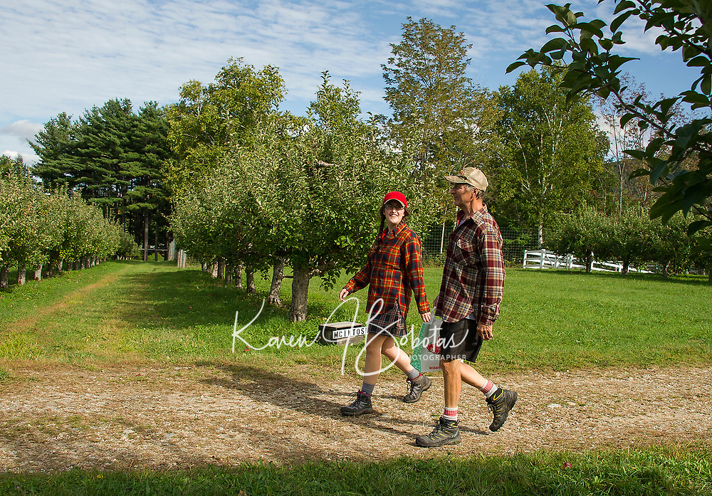 Nikki and Steve Kolb walk into Stone Brook Farm in search of a mix of Cortland and McIntosh apples on Thursday afternoon.  (Karen Bobotas/for the Laconia Daily Sun)