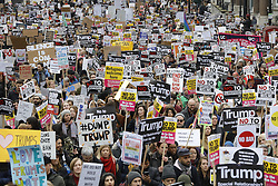 © Licensed to London News Pictures. 04/02/2017. London, UK. Demonstrators march against U.S President Donald Trump's Executive Order banning refugees and immigrants from a number of Muslim-majority countries. Protestors join campaign groups including Stop the War, Stand up to Racism, Muslim Association of Britain, in a march from the U.S Embassy in London to Downing Street. Photo credit: Peter Macdiarmid/LNP