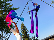 Mindy Cochran and Deidre Ingraham of Levitation Dance Nation, aerialists, performing with silks at Thursday Fest in Kalispell, Montana.