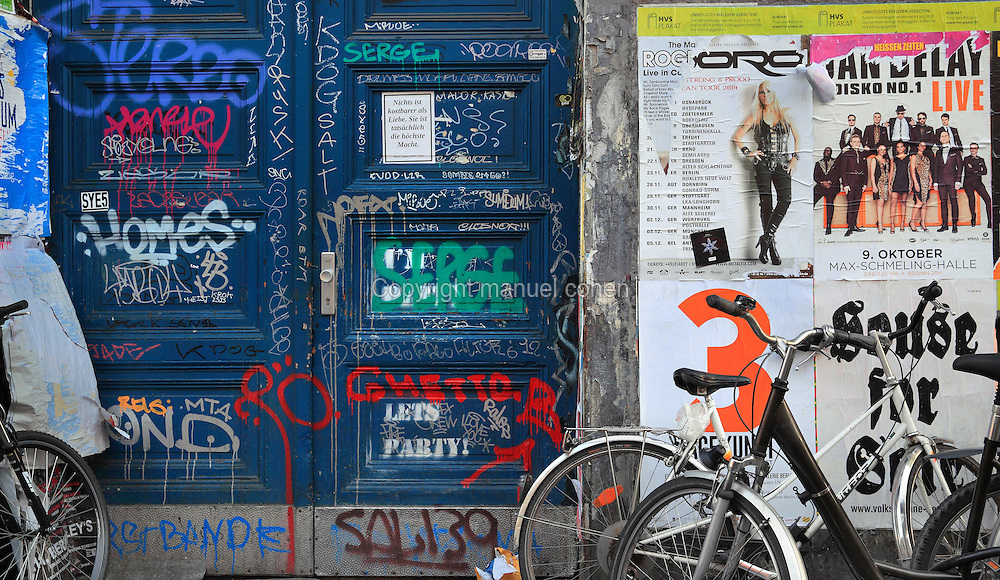 Door covered in graffiti and wall covered in posters, Oranienstrasse, Berlin, Germany. Picture by Manuel Cohen