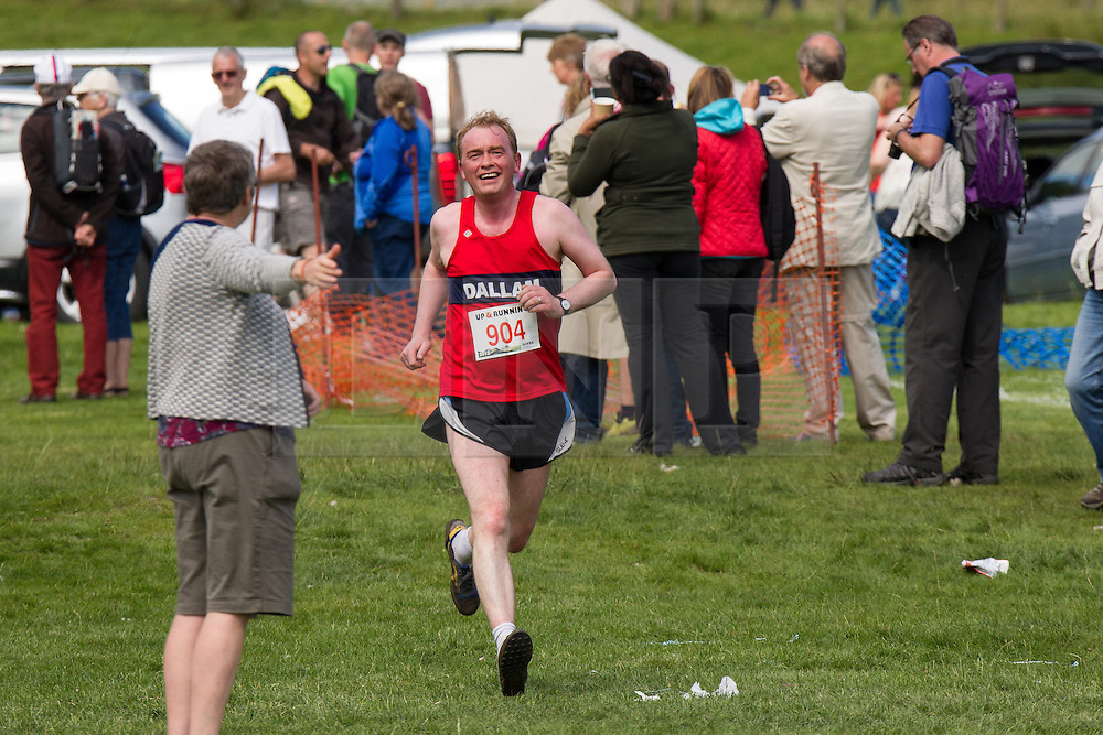 © Licensed to London News Pictures . 30/07/2015 . Ambleside , UK . TIM FARRON , newly elected leader of the Liberal Democrat Party in the UK and MP for Westmorland and Lonsdale , running in a fell race in the Lake District National Park . Photo credit: Joel Goodman/LNP