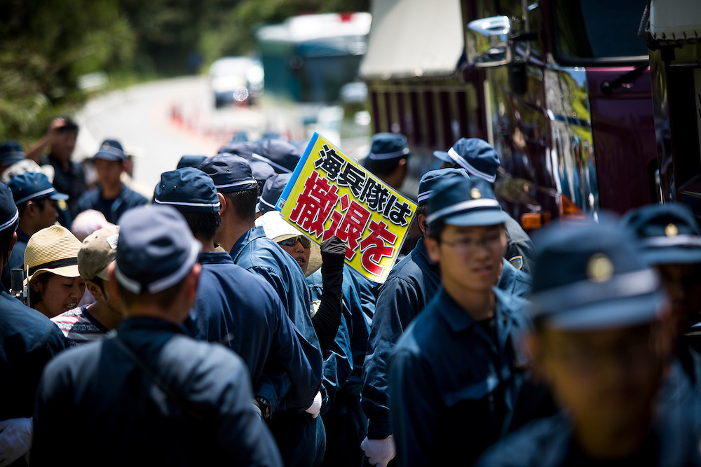 OKINAWA, JAPAN - AUGUST 19 : Anti U.S base protesters is seen with placards after staging a sit-in protest against the construction of helipads in front of the gate of U.S. military's Northern Training Area in the village of Higashi, Okinawa Prefecture, on August 19, 2016. Japanese government resume construction of total six helipads in a fragile ten million year old Yanbaru forest that is home to endemic endangered species such as the Okinawan rail and Okinawan wood pecker. (Photo by Richard Atrero de Guzman/NURPhoto)