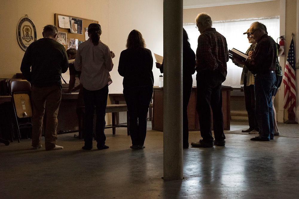 Members of the Amesville Community Choir practice on the first floor of the Amesville Grange Building on East State Street. The choir is one of several programs and classes offered through Village Productions, which is located upstairs. The Amesville Grange Building, which is one of two functioning Grange structures in Athens County, serves as a community center, which local organizations can rent out to host meetings or events, as well as a meeting place for the Amesville Grange.