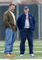 Howie Long (left) and Virginia Cavaliers Head Coach Al Groh.  The Virginia Cavaliers football team opened their spring practice season on March 21, 2007 on the football practice fields behind University Hall in Charlottesville, VA.