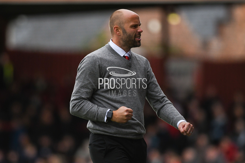 Neil MacFarlane, Manager of Kidderminster Harriers celebrates his team's second goal of the game, to make the score 0-2, during the Vanarama National League match between York City and Kidderminster Harriers at Bootham Crescent, York, England on 15 September 2018.