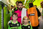Forest Green Rovers goalkeeper Sam Russell(23) with the mascots during the Vanarama National League match between Forest Green Rovers and Tranmere Rovers at the New Lawn, Forest Green, United Kingdom on 22 November 2016. Photo by Shane Healey.