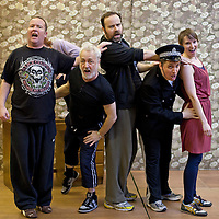 "Picture shows : Paul Riley as Fran,, Jimmy Chisolm as Simon (back), Greg Hemphill as Finlay, Johnny McKnight as Callum (policeman) and Ros Sydney as Morag..Rehearsal of the forthcoming National Theatre of Scotland production 'An Appointment with The Wicker Man'..Picture © Drew Farrell  ( Tel : 07721-735041 ).On a remote Scottish island, the Loch Parry Theatre Players mount their am-dram version of The Wicker Man. When their lead actor goes missing in mysterious circumstances, they call on the services of a television cop from the mainland to step in and save their production. ..The play opens at the MacRobert Arts Centre, Stirling on 18th February 2012 before touring Aberdeen, Glasgow, Inverness and Dunfermline...The Wicker Man regularly tops ""Best Horror Film of All Time"" lists and is regarded as a true film classic. With an unforgettable sense of creeping dread, a wonderfully memorable score by Paul Giovanni, career defining performances from Edward Woodward and Christopher Lee it also has arguably the best ending in cinema history. Now, in an affectionate new adaptation, the National Theatre of Scotland gives a gallus round of applause to this immortal chronicle of strange goings-on in a wee village. 