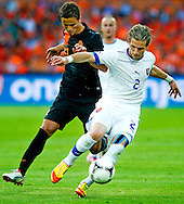 In action for    Ibrahim Afellay (l)  The Netherlands versus Peter Pakarik     Slovakia during friendly soccer match between Netherlands vs Slovakia in Rotterdam on May 30, 2012. AFP PHOTO/ ROBIN UTRECHT