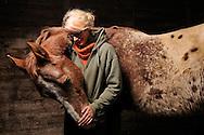 """The 21-year old Daniela Brodmann and her protégé """"Son of Tex"""", named Tex. Daniela Brodmann is an animal keeper on a sanctuary,for old animals specially for horses. The 12-year old Appaloosa stallion was, before he came to the sanctuary, a Western horse. By the frequent """"sliding stops"""" (braking at full speed), which are needed for the Western-competitive riding, make its joints are so worn that it can no longer be ridden. He found shelter at the mercy of the animal rescue charity Freiburg animals and nature eV Daniela Brodmann characterized as follows their relationship with animals: """"They trust me - I trust them."""" Ehrenkirchen-Scherzingen, Germany / Die 21-jaehrige Daniela Brodmann und ihr Schuetzling """"Son of Tex"""", kurz Tex genannt. Daniela Brodmann ist Tierpflegerin auf einem Gnadenhof, u.a. fuer Pferde. Der 12-jaehrige Appaloosa-Hengst war, bevor er auf den Gnadenhof kam, ein Westernreitpferd. Durch die haeufigen """"sliding stops"""" (Abbremsen aus vollem Galopp), die fuer das Western-Turnierreiten  erforderlich sind, sind seine Gelenke so abgenutzt, dass er nicht mehr geritten werden kann. Er fand Unterschlupf auf dem Gnadenhof des Tierrettungsdienstes Freiburg  Hilfswerk Tier und Natur e.V. Daniela Brodmann charakterisiert ihre Beziehung zu Tieren folgendermassen: """"Sie vertrauen mir - ich vertraue ihnen"""". Ehrenkirchen-Scherzingen, Deutschland"""