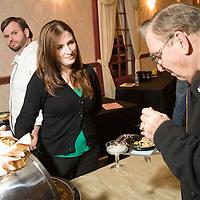 Ed Ofgant samples food from Bon Caldo, as Kaitlyn Wakem and Chef Laiberte watch.