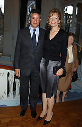 Writer FLORA FRASER and her husband PETER SOROS at a party to celebrate the publication of 'Princesses' the six daughters of George 111 by Flora Fraser held at the Saville Club, Brook Street, London W1 on 14th September 2004.<br /><br />NON EXCLUSIVE - WORLD RIGHTS