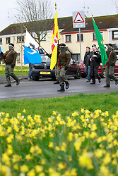 © Licensed to London News Pictures. 26/03/2016. Lurgan, Northern Ireland, UK. A colour party from Republican Sinn Fein parade in Lurgan to mark the centenary of the Easter Rising, this was a rebellion in April 1916 to overthrow British rule in Ireland and eventually led to the formation of the Republic of Ireland. Photo credit: Peter Morrison/LNP