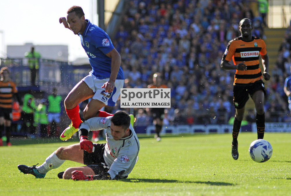Barnet Goalkeeper Jamie Stephens fouls  Kyle Bennett During Portsmouth vs Barnet on Saturday 12th September 2015.