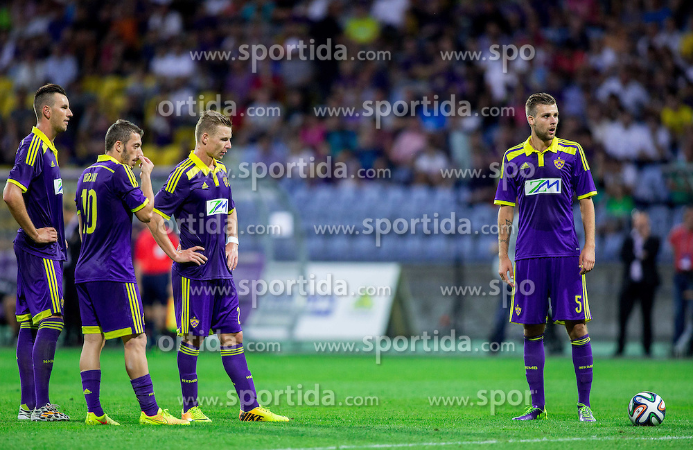 Amir Dervisevic #21 of Maribor, Agim Ibraimi #10 of Maribor, Dare Vrsic #22 of Maribor and Zeljko Filipovic #5 of Maribor waiting for free kick during 2nd Leg football match between NK Maribor and HSK Zrinjski Mostar in Second Qualifying Round of UEFA Champions League 2014/15, on July 23, 2014 in Stadium Ljudski vrt, Maribor, Slovenia. Photo by Vid Ponikvar / Sportida.com