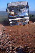 Bus on dirt mountain road in Brazilian Highlands, going to Kalunga quilombo (maroon community), northern Goiás State, Brazil.
