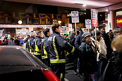 © Licensed to London News Pictures. 14/01/2018 London, UK.  Firefighters lining the streets shake hands and are embraced by participants of a 'silent march' demanding justice for the Grenfell Tower victims seven months after the fire the claimed 71 lives. Survivors, relatives and supporters gathered outside the Notting Hill Methodist Church and walked in silence through Ladbroke Grove stopping traffic in an community organised action repeated on the same night of every month since the devastating events 14 June 2017. The inquiry continues.<br /> Photo credit: Guilhem Baker/LNP