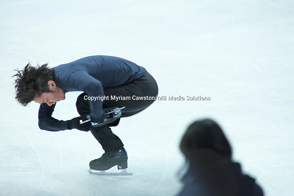 Helsinki, Finland - March 28<br />Figure Skater Shoma Uno, from Japan, spins as  coach Mihoko Higuchi watches on during morning practice session at the main rink of the Harwall Arena ahead of the Figure Skating World Championships. (Photo by Myriam Cawston/MB Media Solutions)